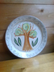 plate with tree decoration by Maddie Millett Ceramics