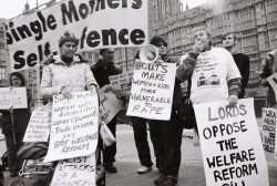 Photograph of protesters with banners