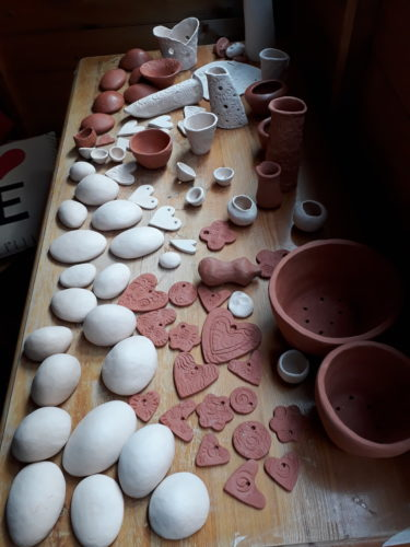Collection of small ceramic pieces – pebbles, hearts etc by Maddie Millett Ceramics
